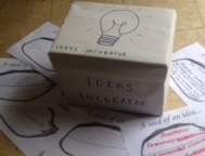 Ideas incubator with seeds of an idea sheet