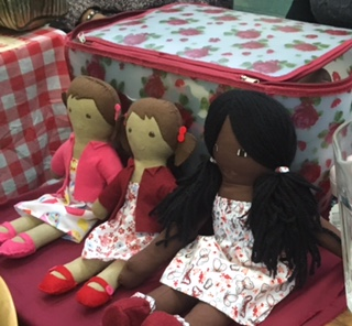 green pop up market rag dolls